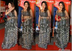 Bollywood and South Indian actress Sridevi looked drop dead gorgeous in a grey floral applique sheer Manish Malhotra saree at SIIMA Embellished floral designs all over saree,Paired with matching sleeveless saree blouse for back. Manish Malhotra Saree, Kareena Kapoor Saree, Indian Bridal Sarees, Crepe Saree, Sari Blouse Designs, Saree Trends, Embroidery Saree, Traditional Sarees, Bollywood Saree