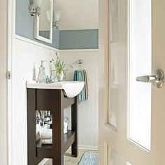 A space-saving vanity and translucent, film-topped glass panels bring light into this small, windowless space while still maintaining privacy.    Photo: John Gruen   thisoldhouse.com