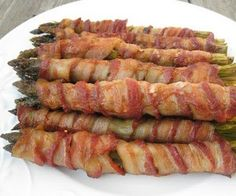 asparagus wrapped in bacon rolled in olive oil, garlic, pepper, bake for 20 min on 350. my new side dish....love it