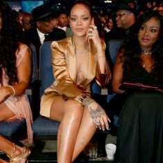Rihanna lounges in a gold tuxedo with a plunging neckline. See more of the best looks from the 2015 BET Awards here.
