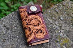Hand made carved Leather wallet.
