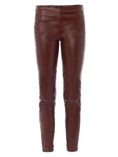 These burgundy leather leggings have a mid-rise, skinny-leg and a horizontal knee seam with a hidden zip expandable hem feature.