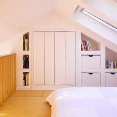 Cottage Cubed - Remodel of a 25sqm Fishermans Cottage. - modern - bedroom - dublin - DMVF Architects. Gorgeous built-in wardrobe and shelving in loft/attic