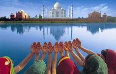 Women in saris in front of the Taj Mahal