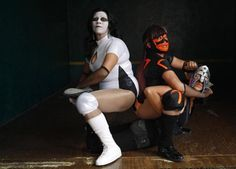 Mexican lucha libre wrestler Catrina (2nd R) poses with fellow wrestlers La Llorona (Spanish for The Crying Lady) and Astrid (R), demonstrating the lock-key wrestling position, at a gymnasium in Mexico City, September 27, 2011. Catrina, 56, a grandmother of seven, has been wrestling for 27 years. She began wrestling while learning self-defense to protect herself from her ex-husband who used to hit her. She is now married to another wrestler.  REUTERS/Carlos Jasso