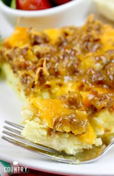 breakfast casserole with crumbled sausage, hash browns and cheese