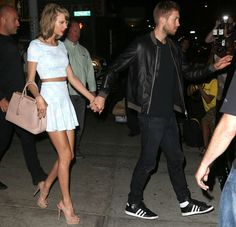 Taylor Swift (with Calvin Harris) in a matching blue printed crop top and mini skirt by Aqua
