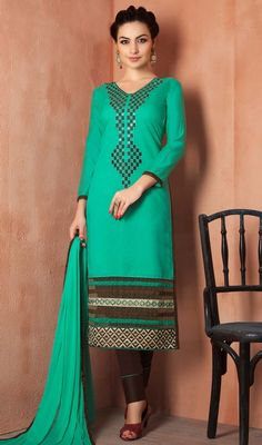 Reign in classic charm and grandeur as you step out in this emerald green color chanderi silk pant style suit. This desirable attire is showing some incredible embroidery done with mirror, lace and resham work. #fancystraightdresses #stylishembroidereddress #fashionablepantstylesuit