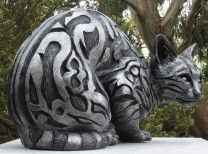 Cast slate resin bengal cat sculpture with deeply carved texture