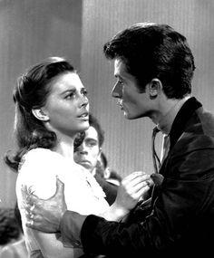 Bernardo (George Chakiris) disciplines Maria (Natalie Wood)