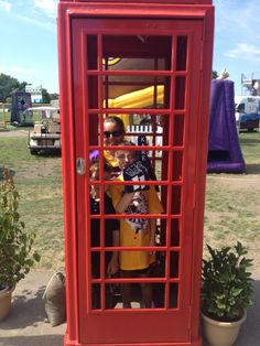 Viking's Fans in the phone booth at Training Camp | #VikingsInUK