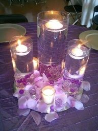 Amber--- super cheap table decorations! Teal flowers, white candles, grey ribbon around the vases. Boom! :)