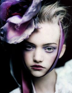 Gemma Ward in a headdress by Stephen Jones, photographed by Paolo Roversi for Vogue UK, March 2004.