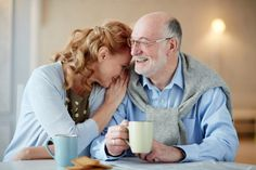 Portrait of smiling senior couple sitting close together cuddling caringly and laughingat kitchen table with tea cups and homemade cookies Tax Free, Free Cash, Funny One Liners, Life Transitions, Stay Happy, Life Purpose, Cuddling, Jokes, Couple Photos