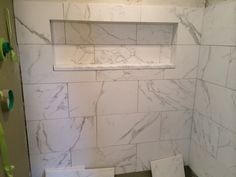 I am building in an area with limited shopping resources. I have access to high end designers and the big box stores. Yesterday I saw at Lowes an American Olean Mooreland Carrara Wall Tile that seemed to blend well with the real marble accent tiles they stock. I plan on having real carrara counterto...