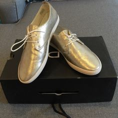 New in box Aldo gold sneakers. Size 8!! Brand new still in box gold Aldo sneakers in a size 8 (box says 9 but they are an 8!) adorable I love them ordered two sizes and two pairs! Retails at $59 these are a steal!!! Also available in silver! ALDO Shoes Sneakers