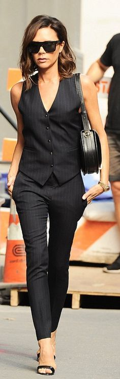 Victoria Beckham: sunglasses and purse – Victoria Beckham Collection  Shoes – Manolo Blahnik