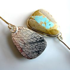 Example of  jump ring suspension in a pendant by Inbar Bareket; Nice way to texture the back as well.