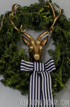 A golden reindeer in a wreath! Plus lots more creative Christmas decorating ideas on this site!