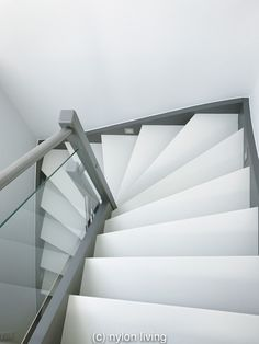 Making a white Corian staircase fit a family house with additional stair materials like wood and glass staircase risers and modern stair banister ideas White Staircase, Staircase Design, House Staircase, Staircase Ideas, Interior Design Masters, Painted Staircases, Stairs Architecture, Landscape Architecture, Glass Stairs