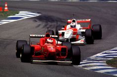 Michael Schumacher & David Coulthard in the Ferrari and Mclaren Mercedes F1 cars 1996