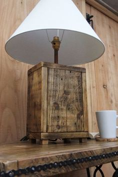 We have made this chunky table lamp from reclaimed pallet wood, full of character and each one unique. Please note these now come with black rubber feet which is better for any surface you put the lamp on. We have given the lamp base in the photos a rustic pine wax finish which treats the wood and enhances the natural colours in it. The lamp has a copper pipe stem and brass switched fitting, 2 metre black cable, black plug and black rubber feet. The fitting is suitable for a standard…