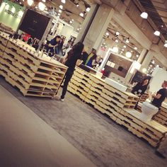 From design_milk. Tradeshow booth made from pallets