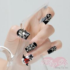Very complex 3d nail art set that features black nail tips with a single white nail tip. The nail tip set features 3d artwork that spider webs designed by metal beads and large metal spider with crystals for its body and head. The white nail tip features a large 3d bat with a red broken heart as its body. This is a very ornate nail set that is perfect for Halloween!All of our nail art pieces are protected by a UV gel top coat.For Custom Orders, please see the following two sections on…