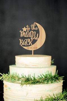 8. Declare your out of this world love with this cute wood topper from WeddingRusticDeco!