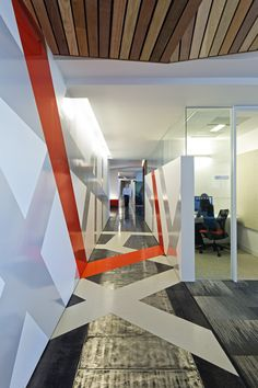 Autodesk SF - Interpreted from the streets of San Francisco, wall and floor graphics define the corridor and main circulation path. Gensler: Workplace Interior Design