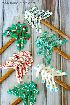 Pretzel Christmas Trees. There are so many possibilities to make these darling christmas trees on a pretzel and kids love sprinkling all of the sprinkles!