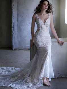 Maggie Sottero - DELILAH, Sometimes a little shimmer   a little texture is all you need in a vintage-inspired sheath wedding dress.