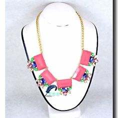 """This playful necklace will show off your girly side perfectly • gold tone  • soft pink & multi colored stones  • 18-21"""" long  • lobster claw closure  • nickel & lead compliant www.FreedomBirdBoutique.StoreNvy.com"""