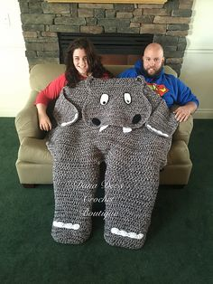 This is a crochet PATTERN for a thick and bulky hippo blanket for two people to share! This whimsical hippo has an adorable face and body, which lies flat across two people, and also has a cocoon leg for each person's feet! Of course, if you don't want to share, you can use one hippo leg for each of yours!