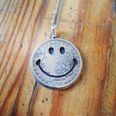 New arrivals from North Works. Made in Japan. Silver dollar. Smiley pendant.
