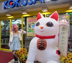 La Carmina, Japanese street style modeling on the cover of Adone Magazine: http://www.lacarmina.com/blog/2013/04/japan-street-fashion-snaps-liz-lisa-adone-magazine/    japanese maneki neko, pachinko parlor, liz lisa dress, my melody, lace girly dress