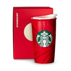 A double-walled ceramic coffee mug with our 2014 Red Holiday Cup design. Part of our Dot Collection.