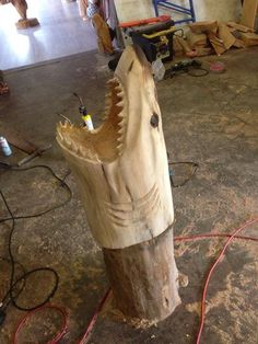 Chainsaw Carving Shark head By: Ryan Anderson's Sculptures in Motion Chainsaw Carvings