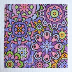 Welcome! Available here is this complete handmade cross stitch kit containing everything you need to stitch this eye-catching design Violet Blooms. Using bold colours around a violet theme, the simple shapes build up together for a fun and modern cross stitch project. This design uses whole cross stitches only for a relaxing project and is of an easy skill level. Full instructions are provided. Within your handmade kit you will find; A piece of DMC 14 count white Aida fabric, 2 wrapped Jo...