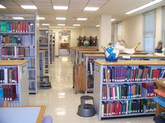 View of low shelving by the windows from the end nearest to the reference desk