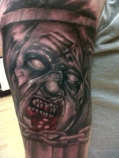Evil dead tattoo done by Roy at Skinshokz.