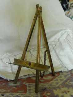 Small old brass easel for doll/dollhouse. Now available in my Ruby Lane shop: KIm's Doll Gems