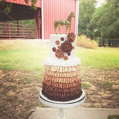 Lauren's Horse Party in hot pink, chocolate brown and gold: ruffle + flower cake with gold glitter horse topper {A Blissful Nest}