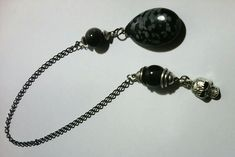 Obsidian and skull pendulum