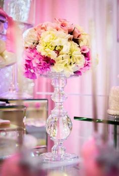 Floral centerpiece at a pink winter wonderland baby shower party! See more party ideas at CatchMyParty.com!