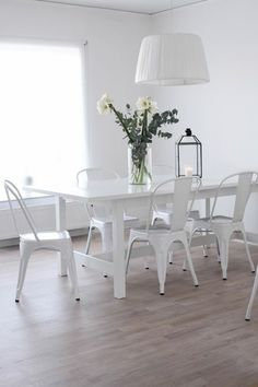 Different chairs but love the all white look