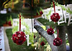 red rose pomander kissing rose balls on shepherd hooks, wedding isle decoration. hanging flower balls.