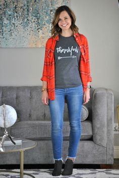 Thanksgiving outfit - plaid shirt, thankful tee, jeans and ankle boots.
