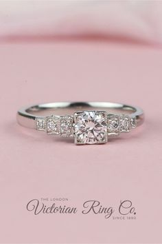 A round brilliant cut diamond can be set in this unusual Art Deco style diamond ring with square central setting. The graduating steps of the diamond-set shoulders lead to a D-shape curved band. #rounddiamondengagementrings #artdecoengagementring #squaresettingengagementring #diamondengagementring #steppedshouldering Unusual Rings, Unusual Art, Square Diamond Rings, Round Diamond Engagement Rings, Art Deco Jewelry, Art Deco Fashion, Ring Designs, Round Diamonds, Diamond Cuts