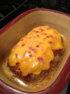 Pampered Chef BBQ Bacon Stuffed Meatloaf in deep covered baker